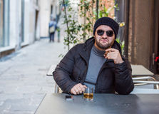 Man drinking whisky, smoking a cigar - making a bad ass look Royalty Free Stock Images