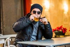 Man drinking whisky, smoking a cigar Stock Photography
