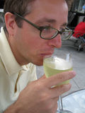 Man Drinking White Wine. On a summer's day royalty free stock photo