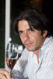 Man drinking wine. Man drinks a glass of red or rose wine in a restaurant Royalty Free Stock Photos