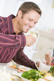Man Drinking Wine At Christmas Dinner Royalty Free Stock Images