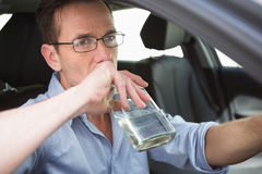 Man drinking wine while driving Stock Images