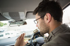 Man drinking wine while driving Royalty Free Stock Image