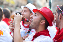 Man drinking wine at opening of San Fermin festiva Stock Images