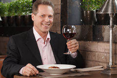 Man drinking wine. Portrait of cheerful businessman drinking Royalty Free Stock Photography