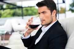 Man drinking wine in restaurant stock image