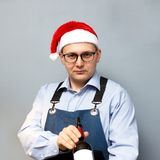 A man is drinking wine in a santa hat royalty free stock photos