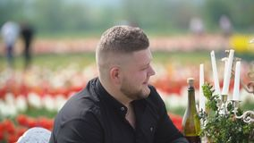 Man drinking wine sitting at the table stock video footage