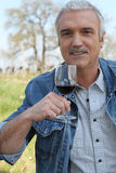 Man drinking wine in vineyard Royalty Free Stock Image
