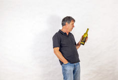 Man drinks alcohol out of a bottle Royalty Free Stock Photography