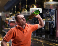 Man drinks alcohol over gray Stock Photography