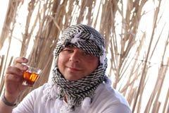 Man drinks Bedouin tea Royalty Free Stock Image