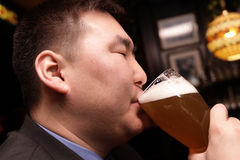 Man drinks beer royalty free stock image