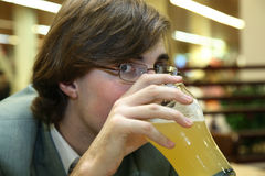 Man drinks beer Stock Images