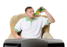 Man drinks beer and watches TV Stock Photos