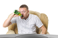 Man drinks beer and watches TV Royalty Free Stock Photo