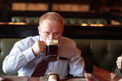 Man drinks brown ale Royalty Free Stock Image
