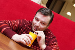 Man drinks coffee. The man drinks a coffee at the cafe royalty free stock photo