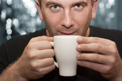 A man drinks coffee Royalty Free Stock Photography
