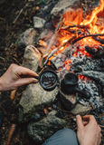 Man drinks hot coffee making on campfire Royalty Free Stock Photos