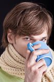 Man drinks hot drink Stock Photo