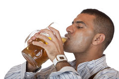 Man drinks out of Oktoberfest beer stein (mass) Royalty Free Stock Photos