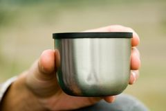 Man drinks tea from a thermos. Photo royalty free stock image