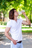 Man drinks water from bottle Stock Photography