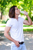 Man drinks water from bottle Stock Photo