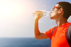 Man drinks water near sea Stock Photo