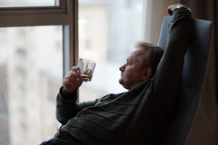 Man drinks whiskey Royalty Free Stock Photography