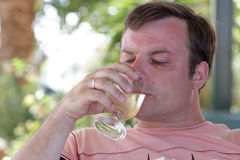 Man drinks white wine Stock Images