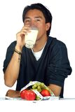 Man drinnking healthy milk Stock Photography