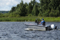 Man drive boat on river Royalty Free Stock Image
