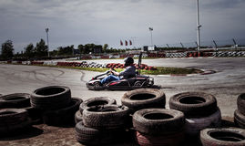 Man drive go kart on track Stock Image