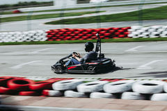 Man drive go kart on track Royalty Free Stock Images