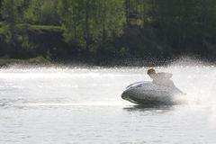 A man drive on high-speed chase on the jet ski. Stock Images