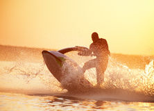 Man drive on the jetski Stock Images