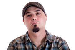 Man with driver cap and plaid shirt Stock Image