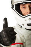 Man in driver costume with thumbs up Royalty Free Stock Photography