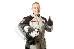 Man in driver costume with thumbs up Stock Photography