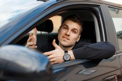 Man driver waves his hands and asks a question. Emotion of surprise royalty free stock photo