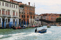 Man drives the blue motorboat in Grand Canal. Venice, Italy. Stock Photo