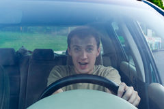 Man drives a car. Emotions Stock Photography