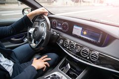 The man drives the car. Business class car. Maybach mersedes royalty free stock photo