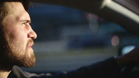 A man drives a car. Close up profile shot stock video footage