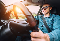 Man drives a car - inside wide angle view Royalty Free Stock Photography