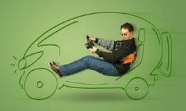 Man drives an eco friendy electric hand drawn car. Concept Stock Photo