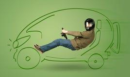 Man drives an eco friendy electric hand drawn car Stock Photos