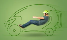 Man drives an eco friendy electric hand drawn car Royalty Free Stock Photography